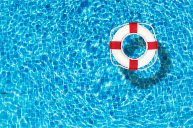 Life preserver floating in a clear pool water stock vector