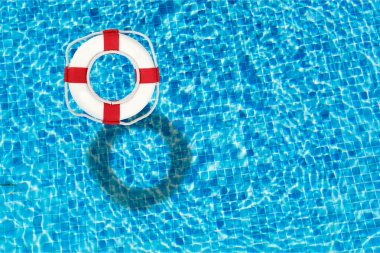 Life preserver floating in a clear pool