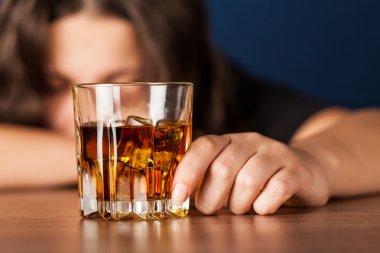 woman in depression, is drinking alcohol