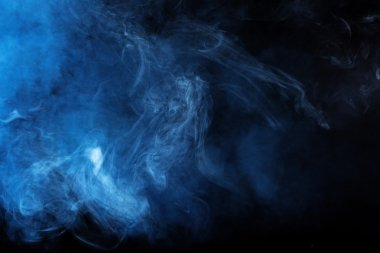Blue smoke over  studio background