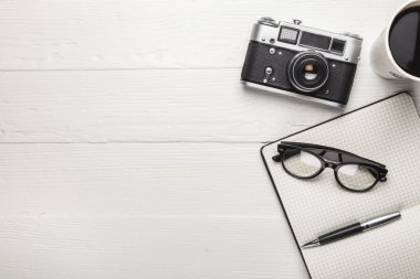 Vintage camera, diary and coffee