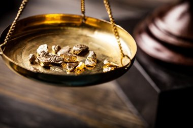 Small gold nuggets in measuring scale