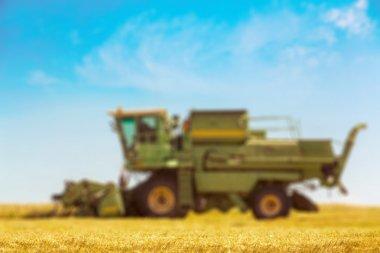 Combine machine  on farm field