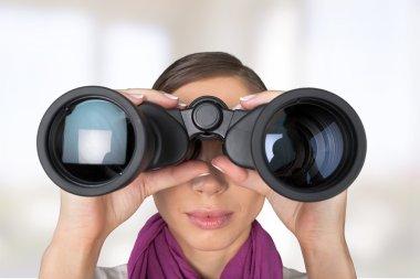 Girl looking into binoculars