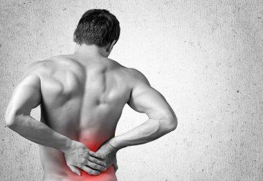 man touching his aching back