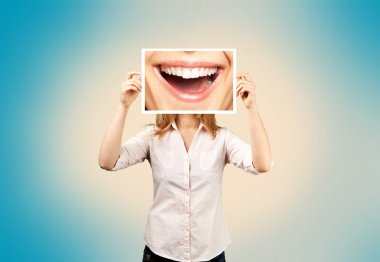 woman holding picture with big smile.