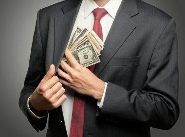 Businessman hiding dollars banknotes