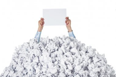 Person under crumpled pile of papers with hands holding a blank page stock vector