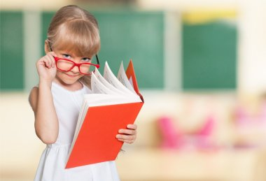 little student girl with  book