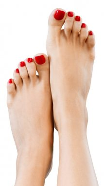 Beautiful female legs with red pedicure