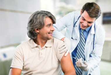 doctor making vaccination to patient