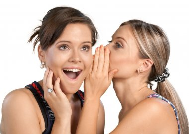 Woman revealing secret to friend