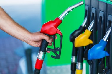 man's hand holding a petrol pump