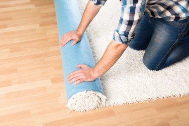 male hands rolling carpet