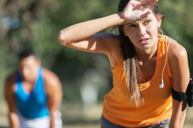 Sporty woman getting ready for  running