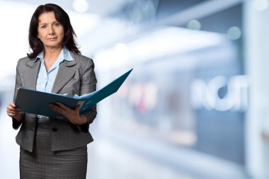 Female finance advisor holding folder