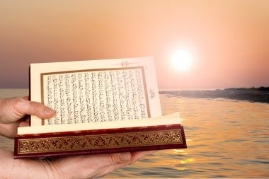 Islamic Book Koran in hands