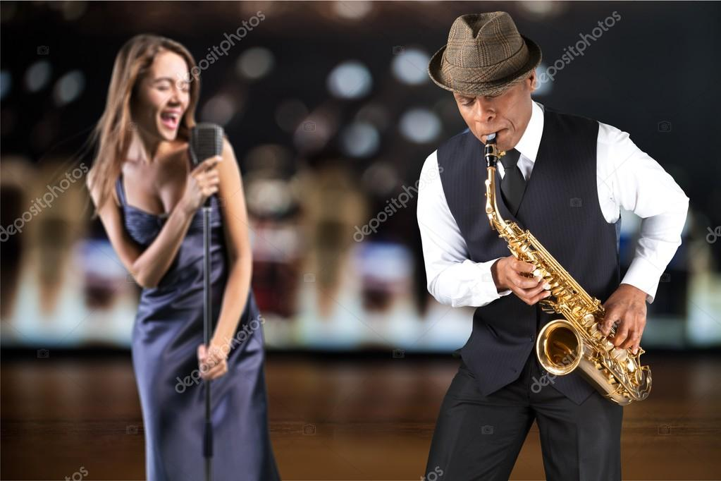 female singer and male saxophonist  playing