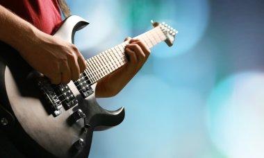 man guitarist playing music
