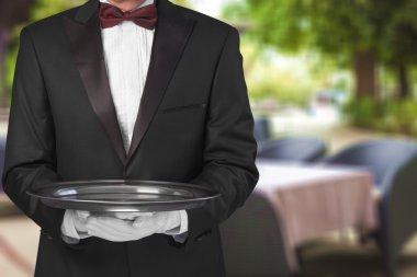 waiter hand  holding an empty plate
