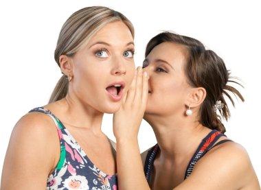 Woman revealing secret to her friend