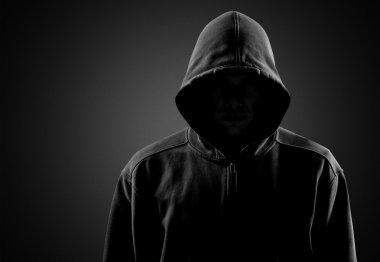 Dark unrecognisable man in hoodie