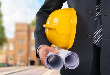 construction worker man holding in  blueprint