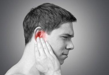 man having ear pain