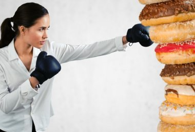 young woman fighting off fast food