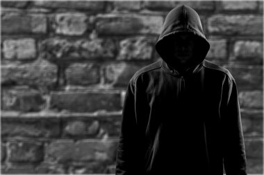 Dark unrecognisable man in hoodie