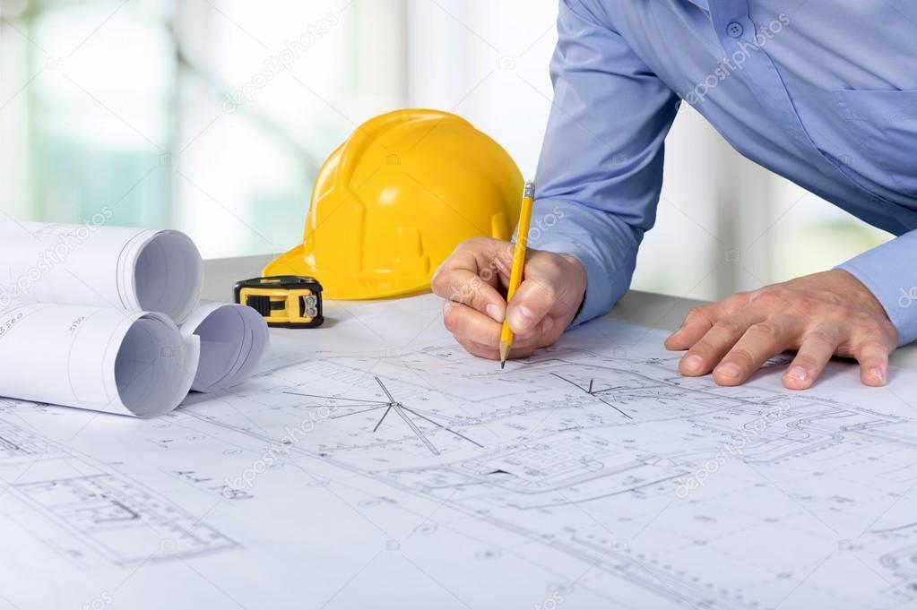 Architect working on construction blueprint stock photo architect working on construction blueprint stock photo malvernweather Image collections