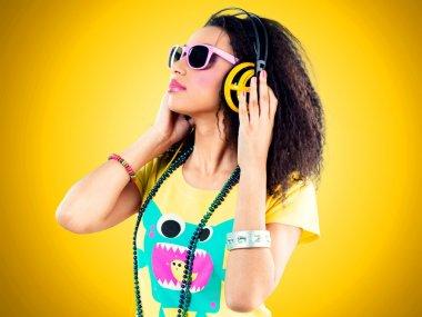 beautiful african girl with headphones
