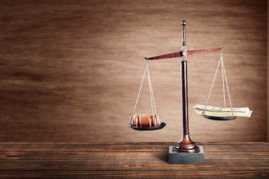 Justice Scales with money  and wooden gavel