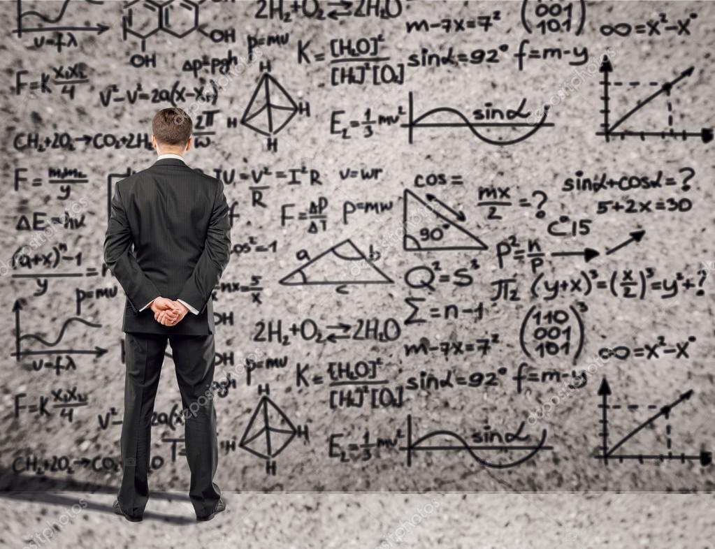 Businessman solving math problem — Stock Photo © billiondigital ...