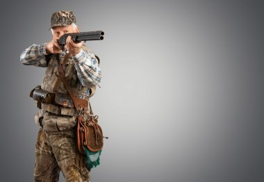 male hunter standing with gun