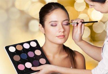 makeup artist doing makeup girl