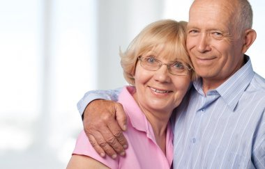 happy senior couple smiling at home