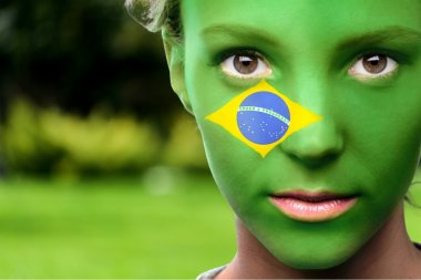 woman with the flag of the Brazil
