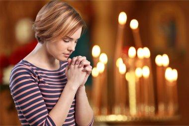 woman praying in a church