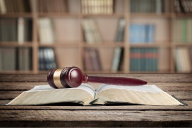 book and wooden gavel on table