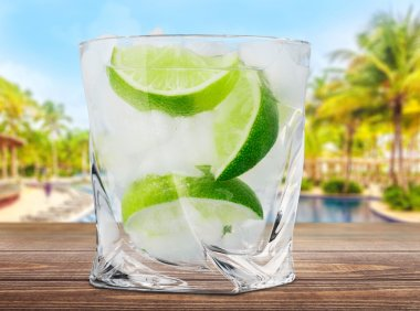 Gin. Cocktail with ice and lime slice isolated on white background