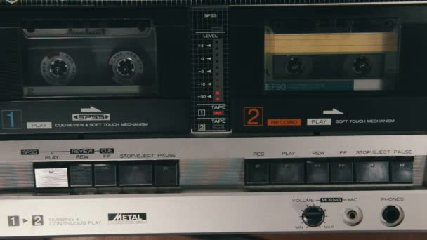 Pushing a Finger Play and Stop Button on a Two Decks Tape Recorder