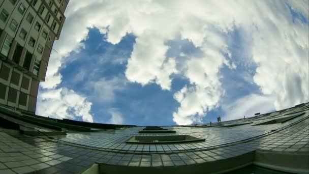 Clouds Moving Over The Multistorey Buildings. Time Lapse
