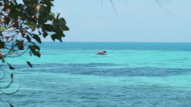 Little African Boat Sailing with Tourists in Turquoise Waters of Indian Ocean