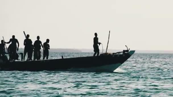 Funny Dancing African Fishermen on Wooden Motor Boat Floating by Ocean, Africa