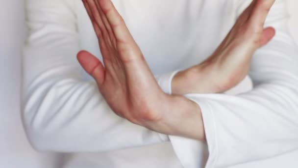 Man shows gestures and signs with his hands.