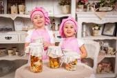 Young cook hostesses with tasty bottled food
