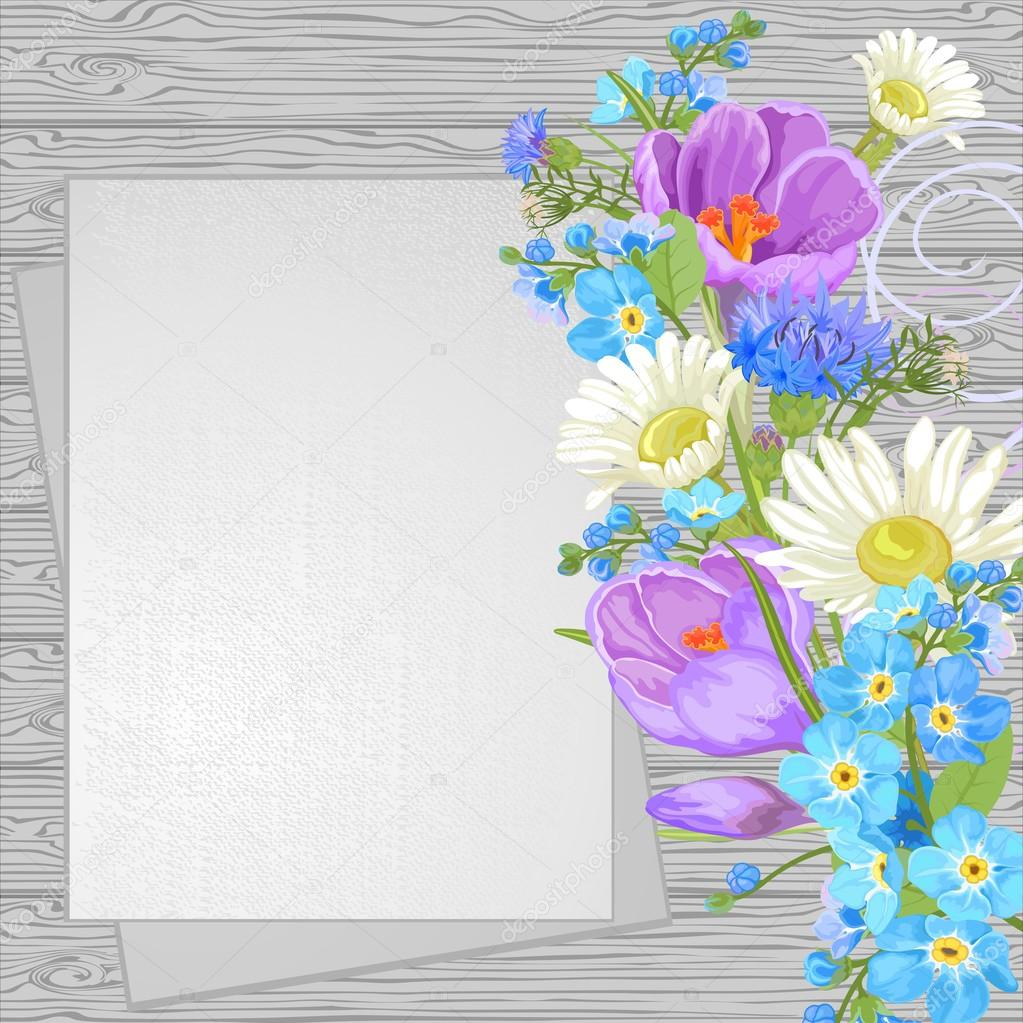 Spring flowers on a wooden background, top view