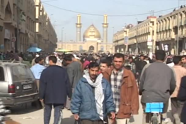 Iraqis walk street and shop in a busy outdoor market of Baghdad, Iraq