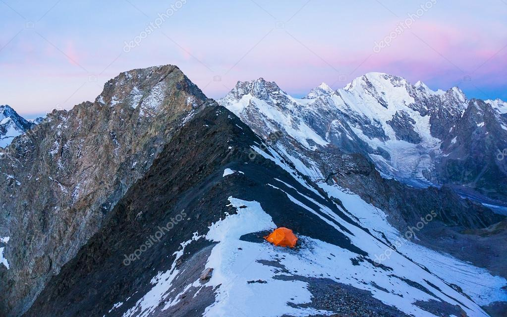 Lonely orange tent climbers in the high moutains u2014 Stock Photo & Lonely orange tent climbers in the high moutains u2014 Stock Photo ...